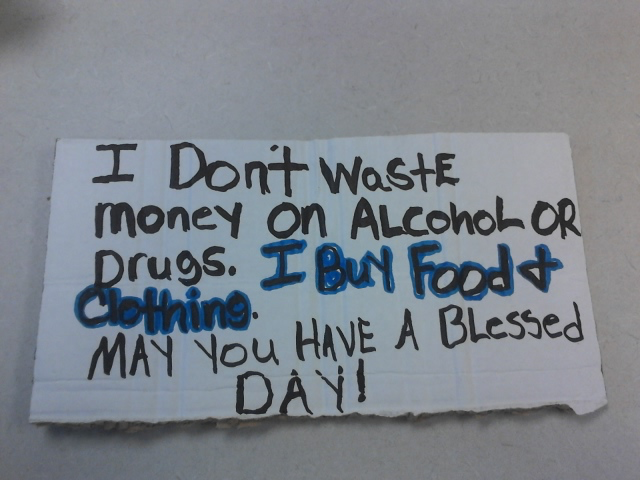 Reads: I don't waste money on alcohol or drugs. I buy food and clothing. May you have a blessed day!