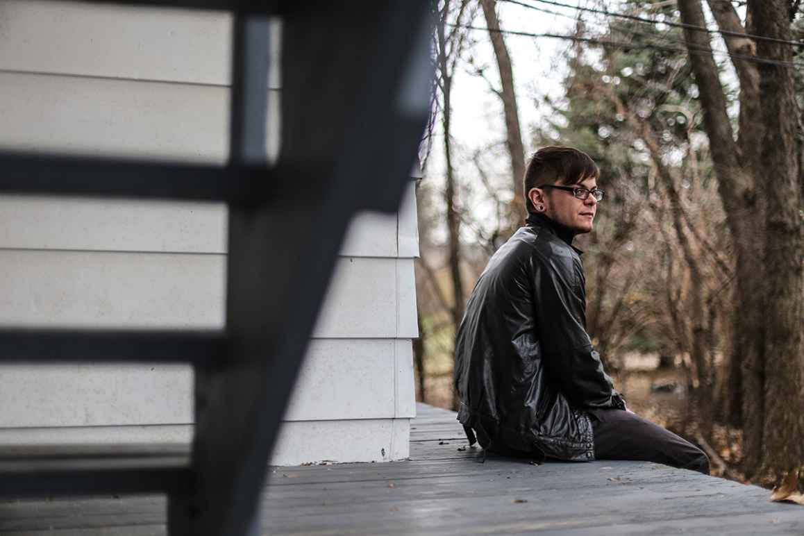 Dylan sitting on his porch outside of his home.