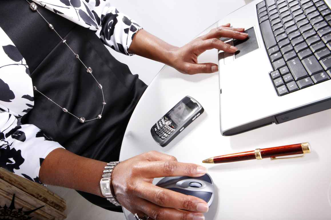 Photo of a Black woman at a computer