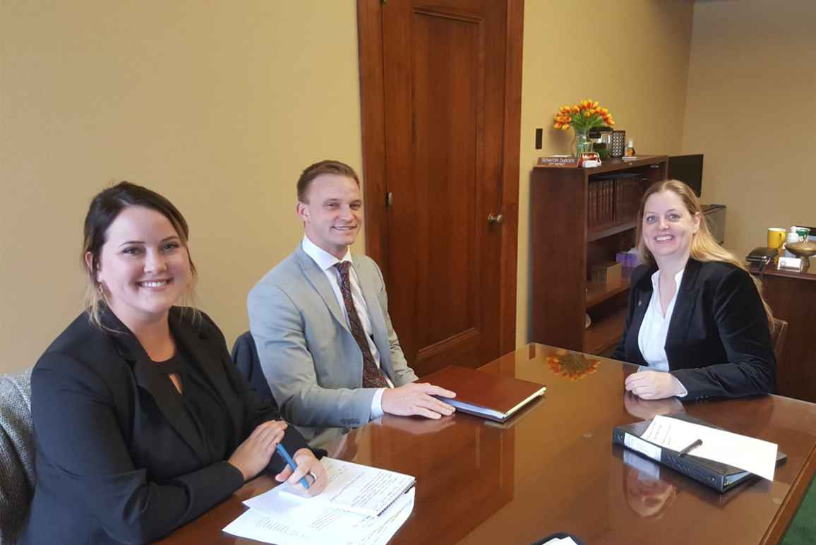 Nebraska Law Civil Clinic students Erin Olsen, an ACLU law clerk, and Josh Waltjer meet with Senator Wendy DeBoer to discuss a bill the Senator has introduced to clarify Nebraska's conviction set-aside law.