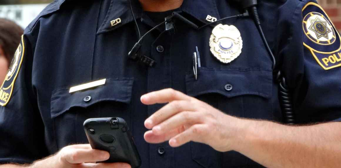 Law enforcement officer with a cell phone