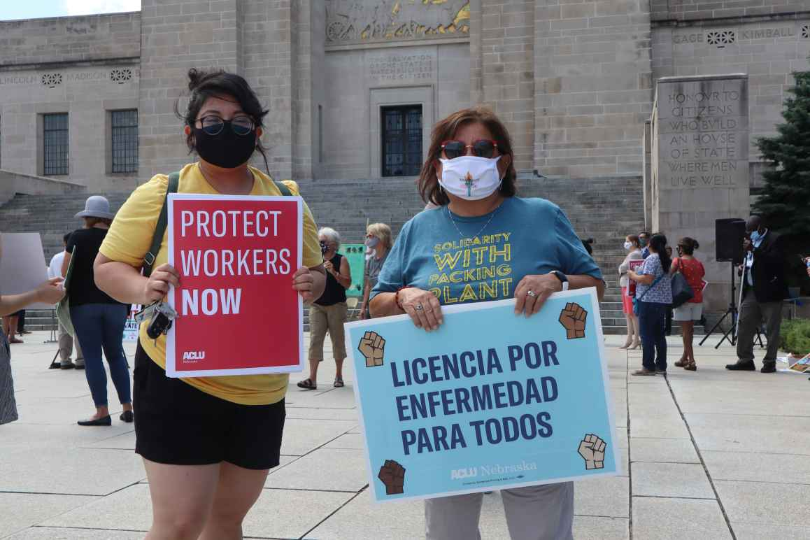 ACLU Legal & Policy Counsel Rose Godinez stands next to ACLU Board Member Yolanda Nuncio at a demonstration in support of essential workers.