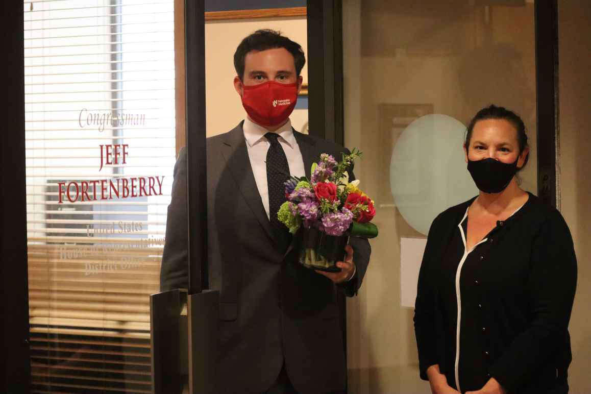 ACLU of Nebraska Executive Director Danielle Conrad drops off flowers at Rep. Fortenberry's district office in Lincoln.