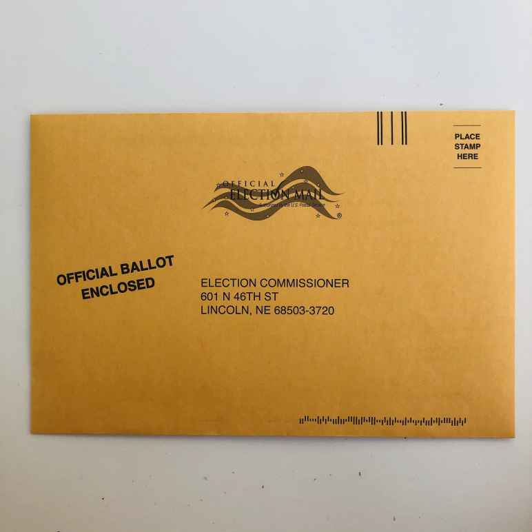 """Yellow envelope that says """"Official Ballot Enclosed"""""""