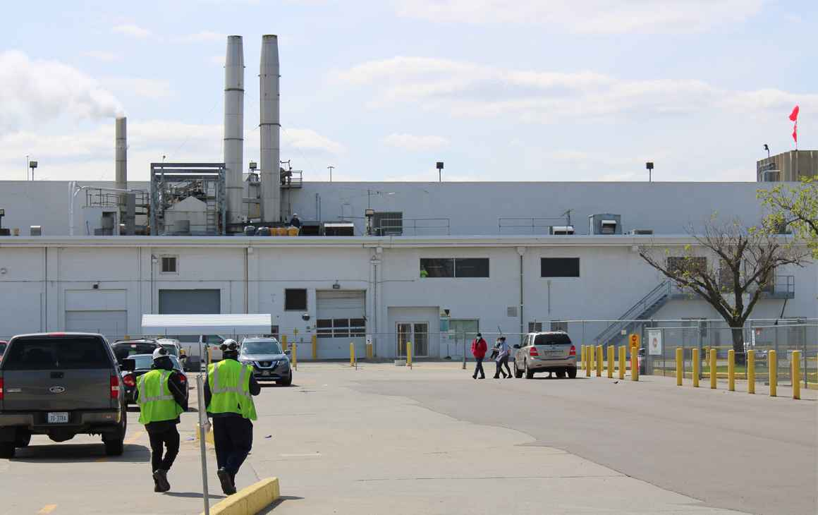 Two workers walk toward the Tyson Foods processing plant in Dakota City, Nebraska.