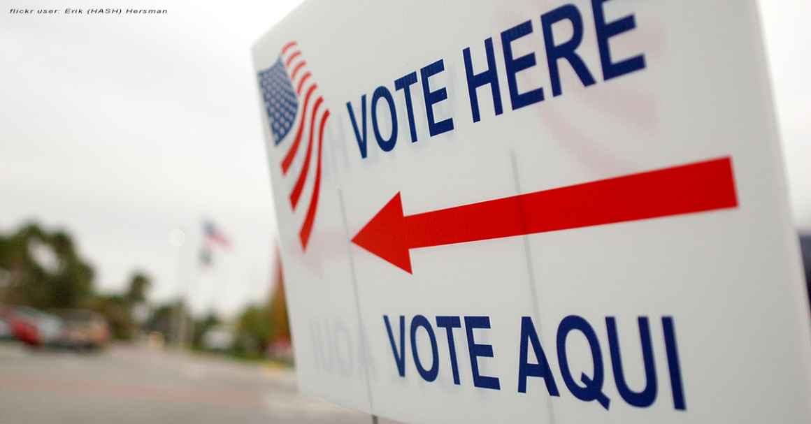 "Sign near a polling place saying ""Vote Here"" and ""Vote Aqui"""