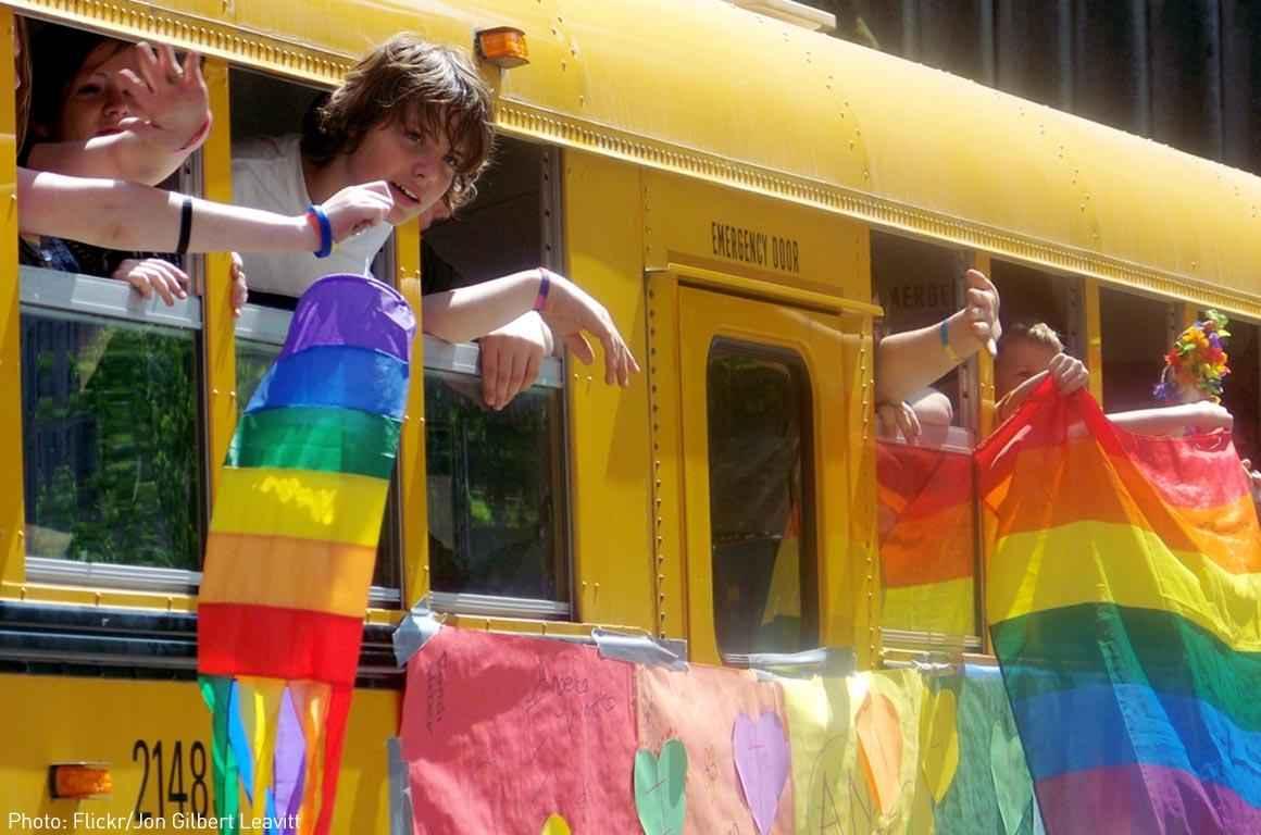 School bus with rainbow flags