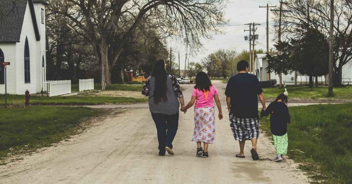 Alice, Norma, and their children walk together in Kilgore, Nebraska
