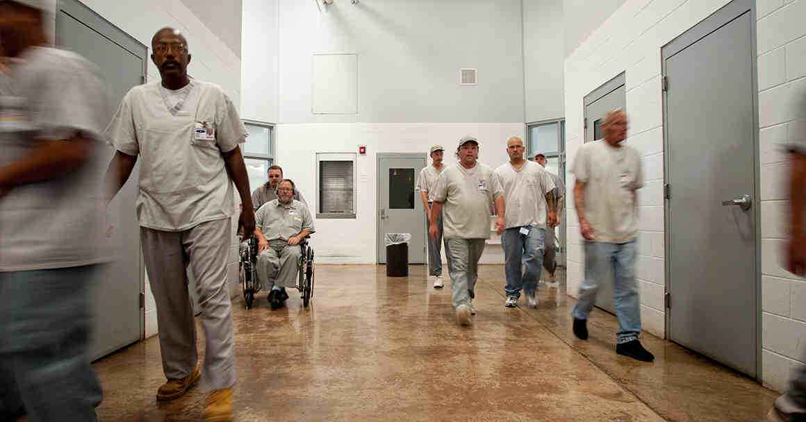 Photo of prisoners in a hallway